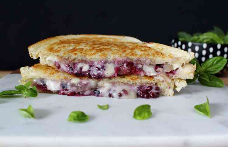 Blackberry Basil Brie Prosciutto Grilled Cheese - Taking the classic up a notch! Fresh blackberries smashed with basil, creamy brie and salty prosciutto come together for a fabulous sweet & savory grilled cheese sandwich.