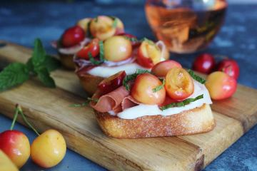 Rainier Cherry Crostini on a wooden board