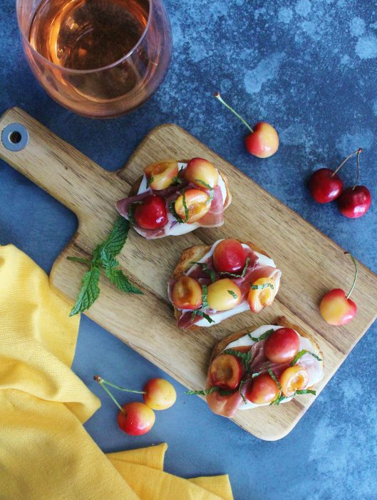 Rainier Cherry Crostini with a glass of rose wine.