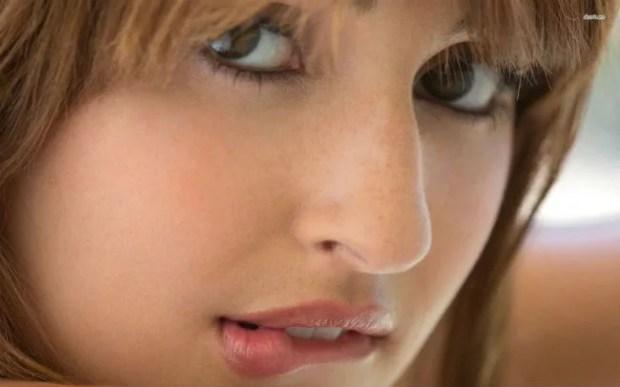 girl biting her lips
