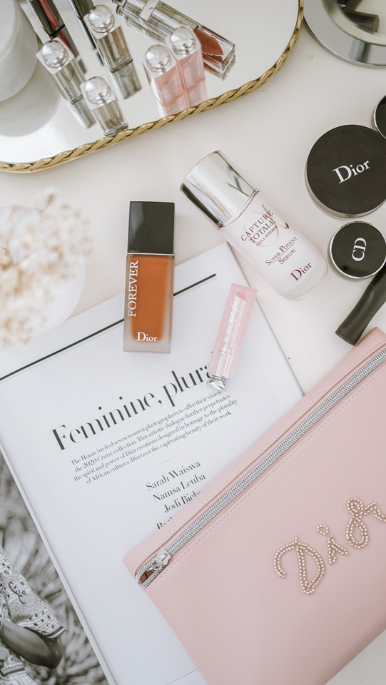 Dior forever foundation, Dior lip glow, Dior capture totals serum and Dior make up bag flatlay #diorforever