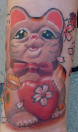 Lucky Cat Tattoo. Placement: Arm Comments: No Comment Provided.