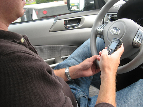texting photo - At Last! Texting While Driving Tickets Soar in NY, says NY and PA Accident Lawyer
