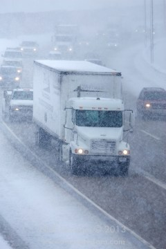 White Truck on Interstate Highway in Snow - Monday's Mayhem Reminds Us That Tractor-Trailers Pose Special Danger On Highways During Winter, Says NY And PA Injury Lawyer