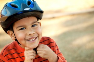 boy with helmet - Q & A: Take Time To Prepare Your Children To Ride Safely This Year, Says NY and PA Bicycle Lawyer