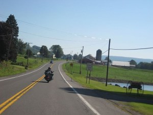 biker on finger lakes road - NY Motorcycle Accident Lawyer to Drivers: Look Twice for Motorcycles!
