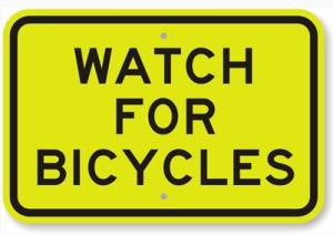 caution sign 300x212 - For Drivers, Crash Involving Young Bicyclist Is A Reminder To Look Twice