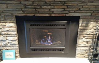 Fireplace X 34 DVL gas insert with Blk Metro face and custom cut inside fitting surround