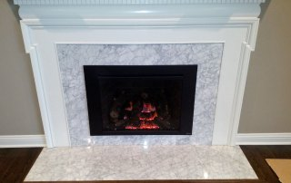 616 Gas Insert with Times Square face. Custom tile around the old fireplace. No surround used