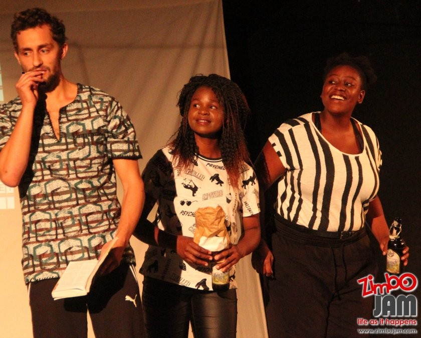 A scene from the play Black and white ain't colours