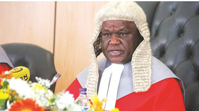 Chief Justice Malaba back in office