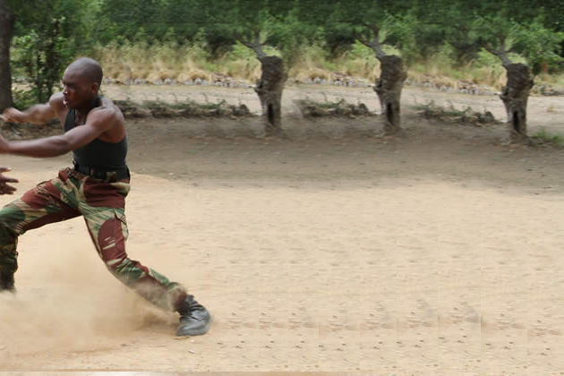 SOLDIER RUNS FOR DEAR LIFE AS WIFE BUSTS HIM WITH SMALL HOUSE