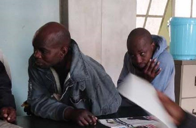 Captured armed robbers face the law