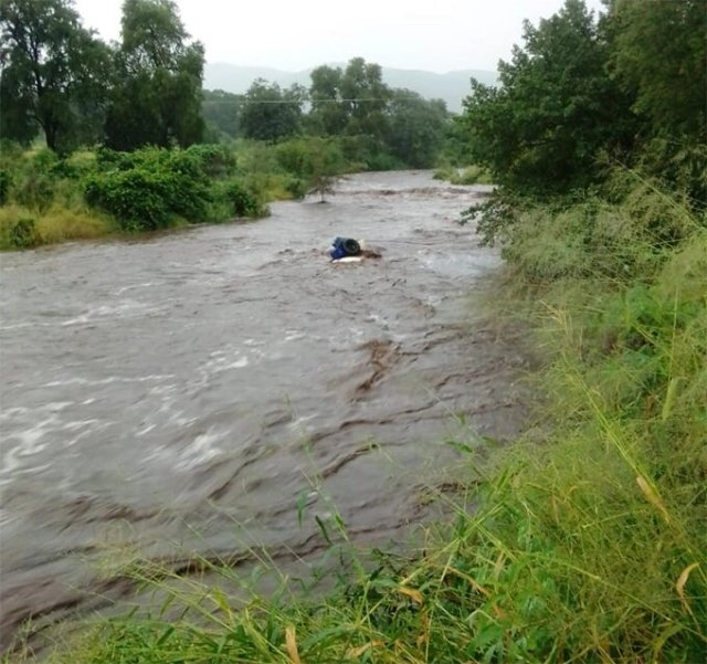 Car Swept By River, Six Missing