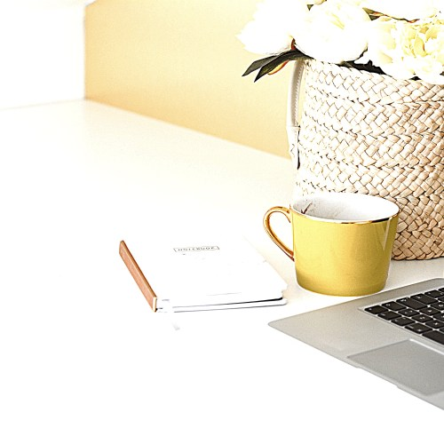 notebook, keyboard and a cup
