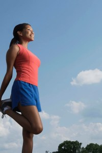 a woman with red top and blue shorts