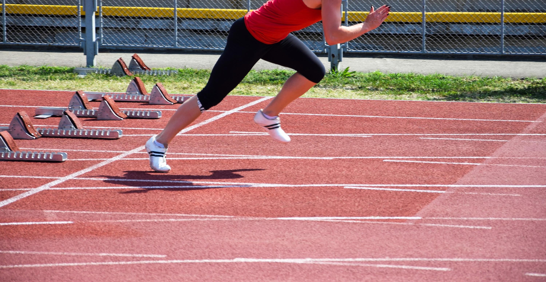 Runner is starting on the running track