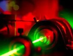The green laser is shown as it leaves the ruby crystal. (c) University of Glasgow