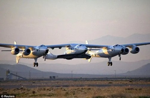 Virgin Galactic's SpaceShipTwo is shown on its maiden flight from the Mojave Air and Spaceport in Mojave, California in March 22, 2010. (c) Reuters