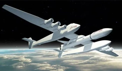 The giant Stratolaunch aircraft, with a wing span the size of a football field, is set to piggyback rockets for easy orbit deployment. (c) Dynetics/Stratolaunch Systems