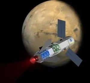 A concept image of a spacecraft powered by a fusion-driven rocket. In this image, the crew would be in the forward-most chamber. Solar panels on the sides would collect energy to initiate the process that creates fusion. (c) University of Washington