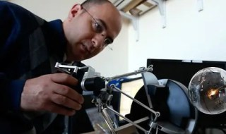 Nabil Simaan testing a surgical robot that he designed. (Joe Howell / Vanderbilt)