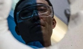 Ke Sun's reflection onto a sample coating with the nickel oxide film his team developed. Image: Lance Hayashida, Caltech Marcomm