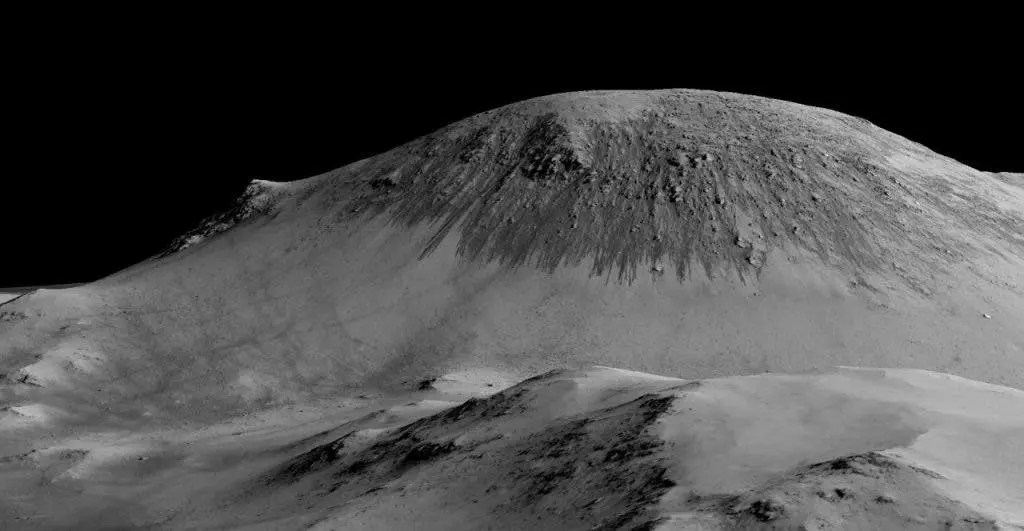 Dark narrow streaks called recurring slope lineae seen here flowing on a Martian mountain. That's flowing water mixed with perchlorates. Image: NASA/JPL