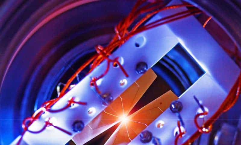 This device uses four segmented blade electrodes to trap atomic ions for quantum information processing. Credit: Emily Edwards