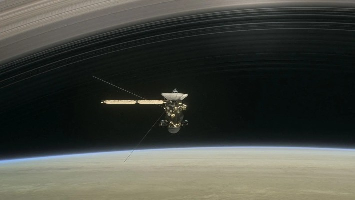 Artist illustration of Cassini diving through Saturn's rings. Credit: NASA.