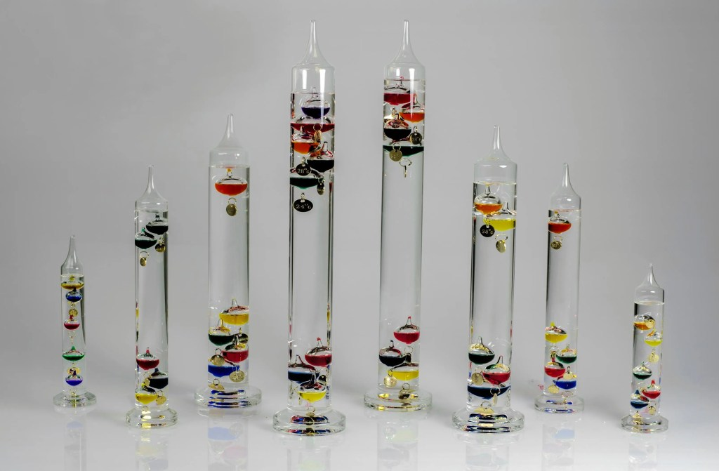 An assortment of Galileo thermometers of various sizes. The bigger the size, the more precise the instrument. Credit: Amazon.