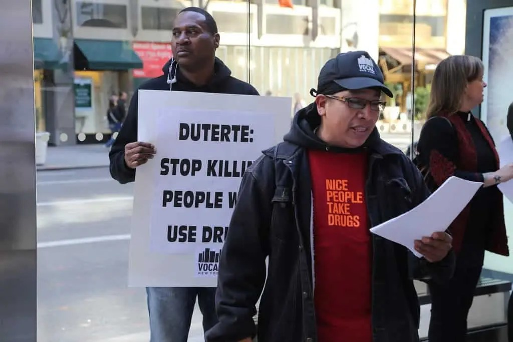 People protest against Philippine President Rodrigo Duterte's war on drugs. The death toll so far is estimated at 13,000. Credit: Flickr, Wikimedia Commons.