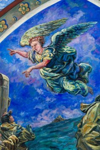 Painting detail of Angel Michael as he flies over the Saint Michaels Mount and speaks to the fishermen the painting hangs in All Saints Church Marazion