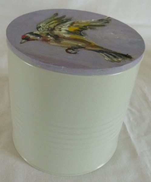 SHOPPING : painting of a yellow finch flying painted onto the wooden lid of a container