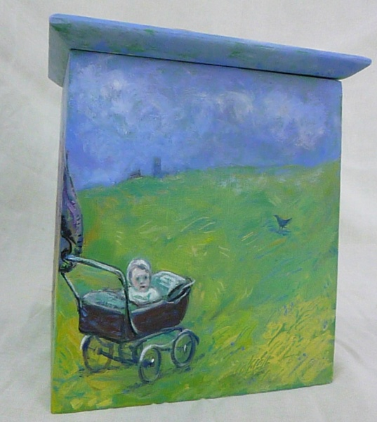 SHOPPING : A painted wood biscuit box with a lid by artist Zoe Cameron of a circus elephant pushing a baby in a pram on green grass with blue sky