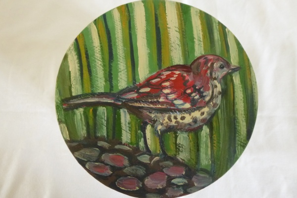 painting of a Thrush hiding in the grass on the wooden lid of a container