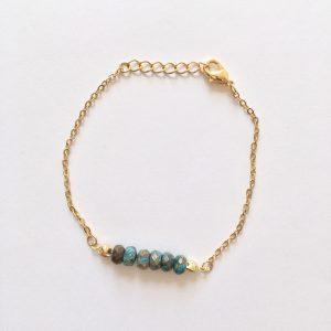 Armband met blauw bruine natuursteen goud