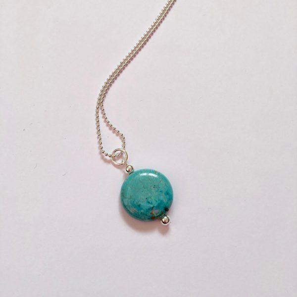 Lange ketting met turquoise natuursteen vier zilver