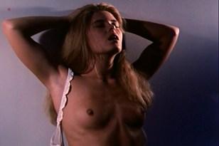 Nicole Eggert nude butt, topless and sex - Blown Away (1992)