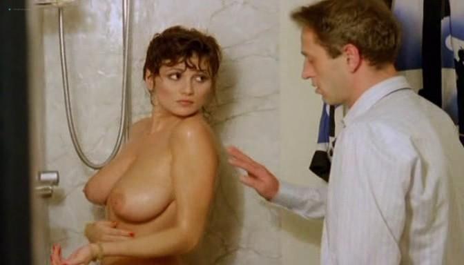 Serena Grandi nude topless bush full frontal oral and near explicit - Desiderando Giulia (1986) (6)