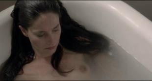 Marie Gillain brief topless in the bath - Landes (2013)