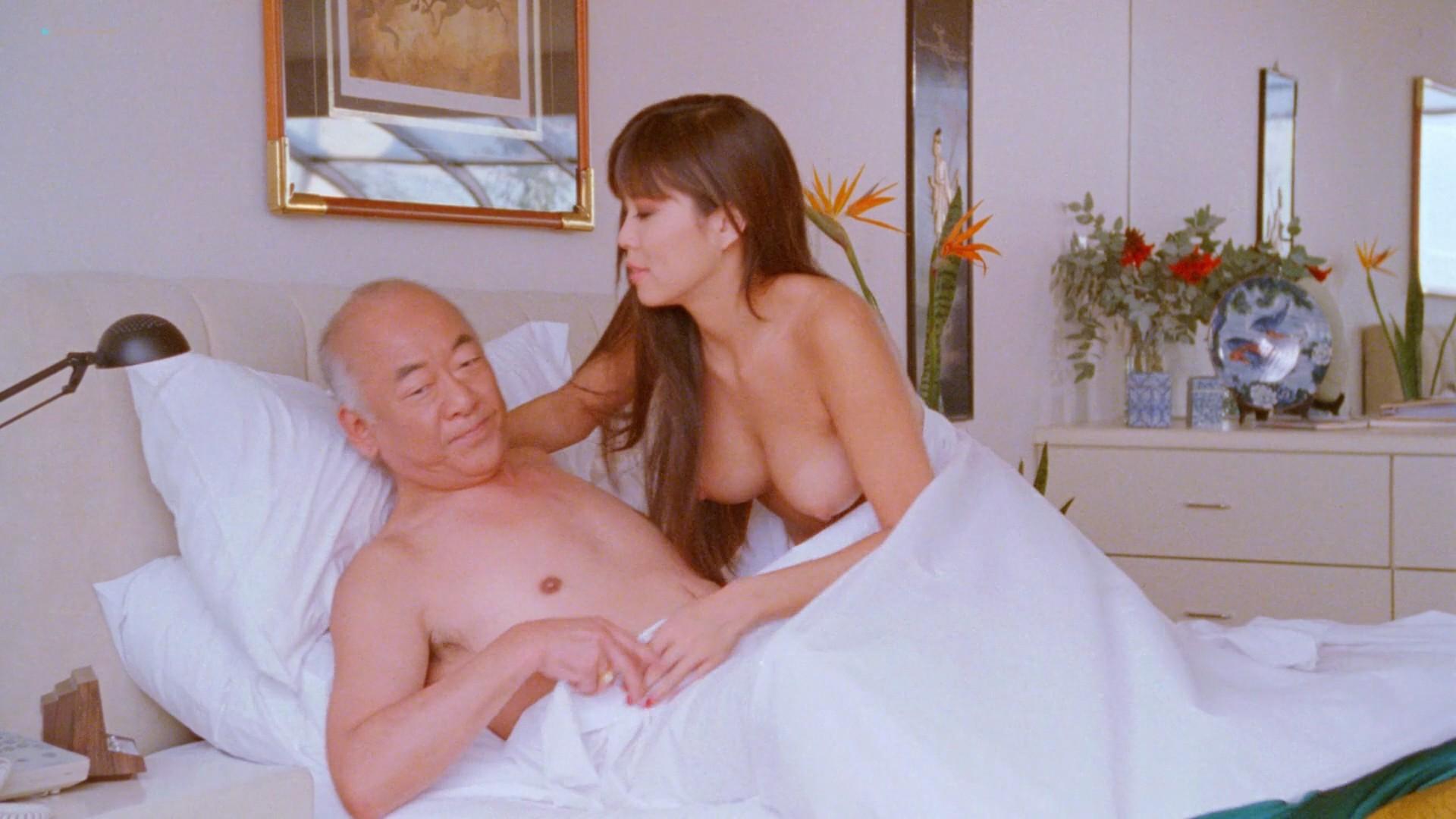 Dona Speir nude Pandora Peaks, Carolyn Liu and others nude too - Do or Die (1991) 1080p BluRay (9)