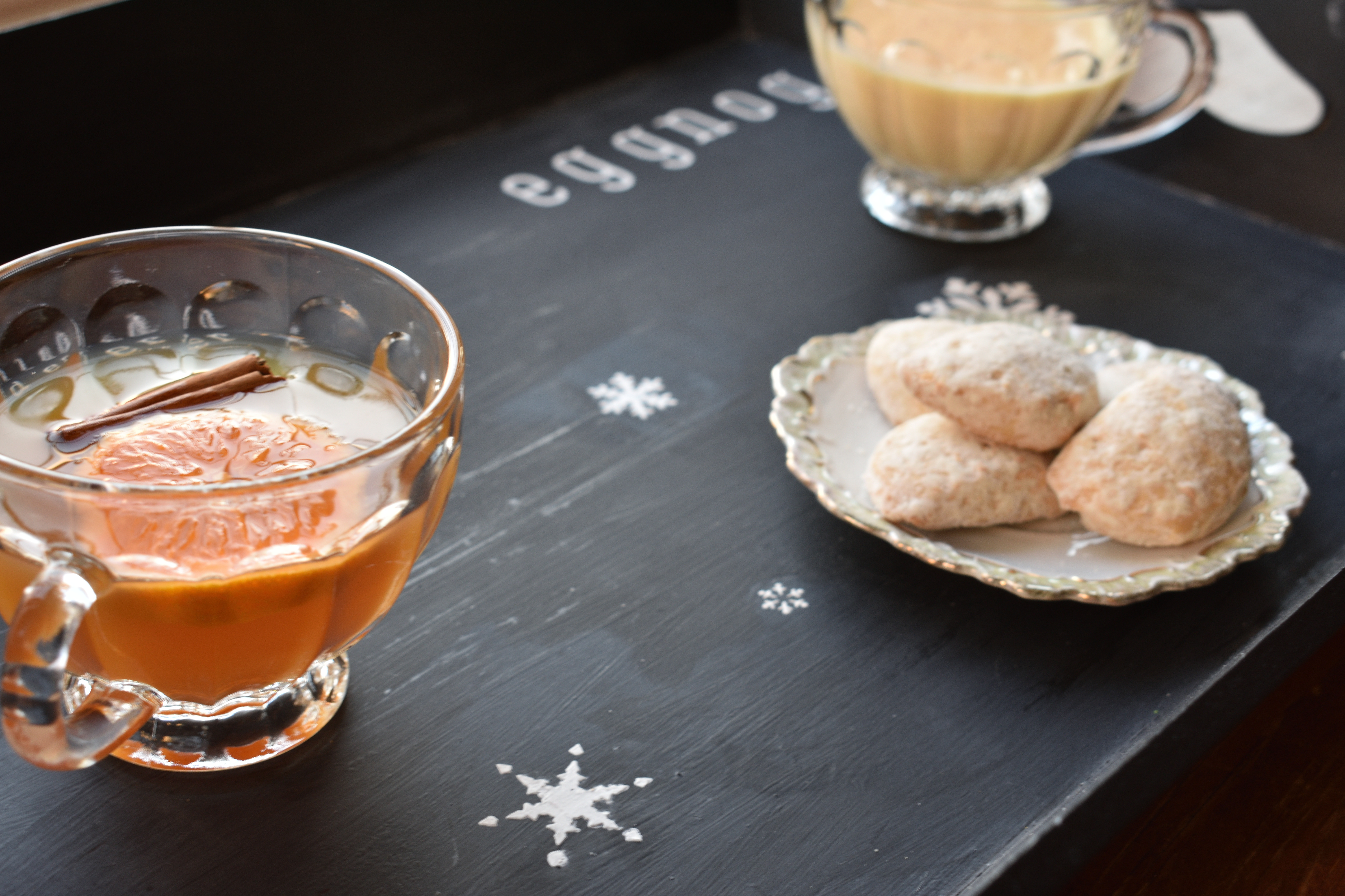 chalkboard holiday serving tray with cookies, mulled cider and eggnog