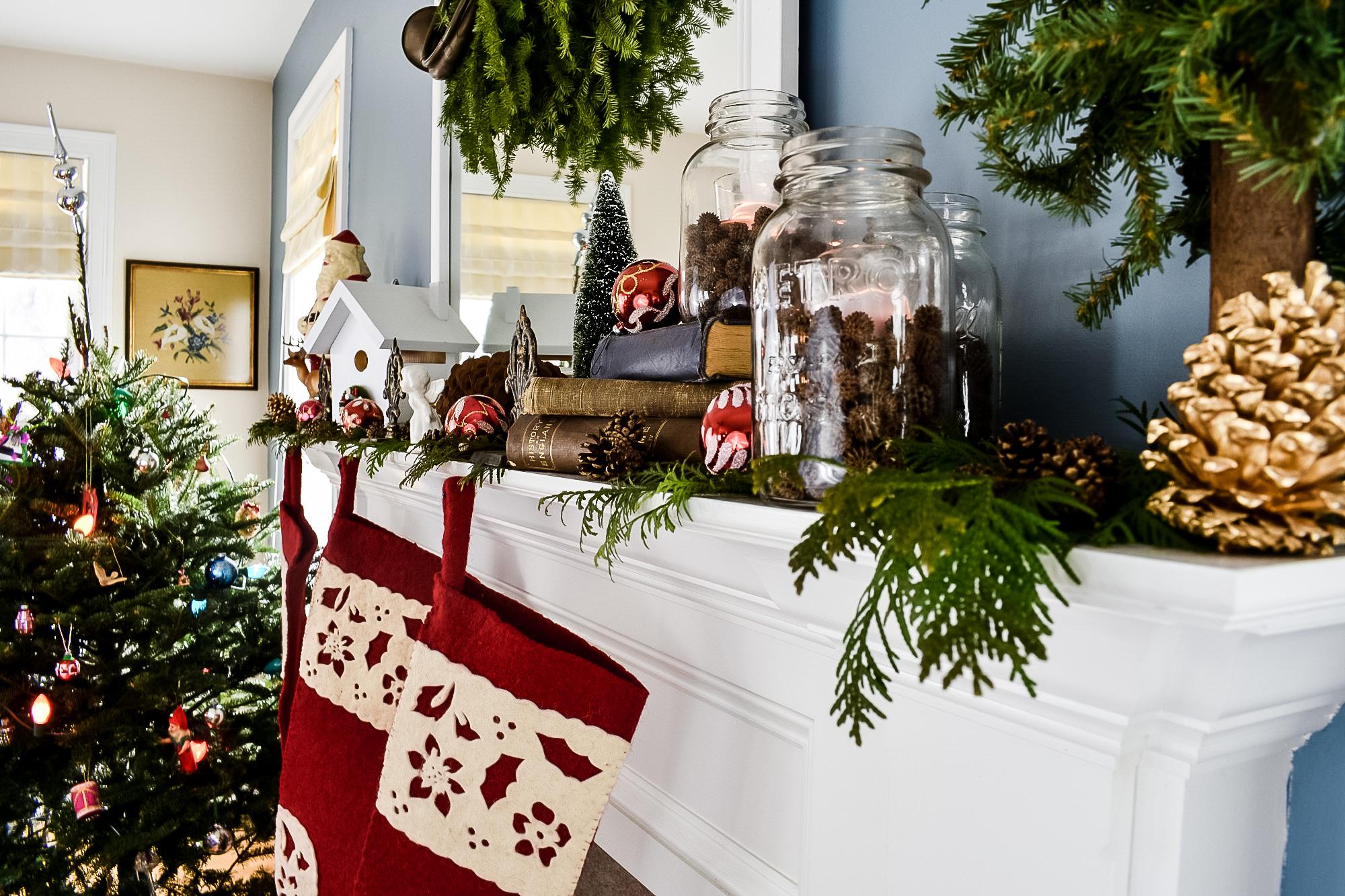 red felt stockings hung on a Christmas mantel