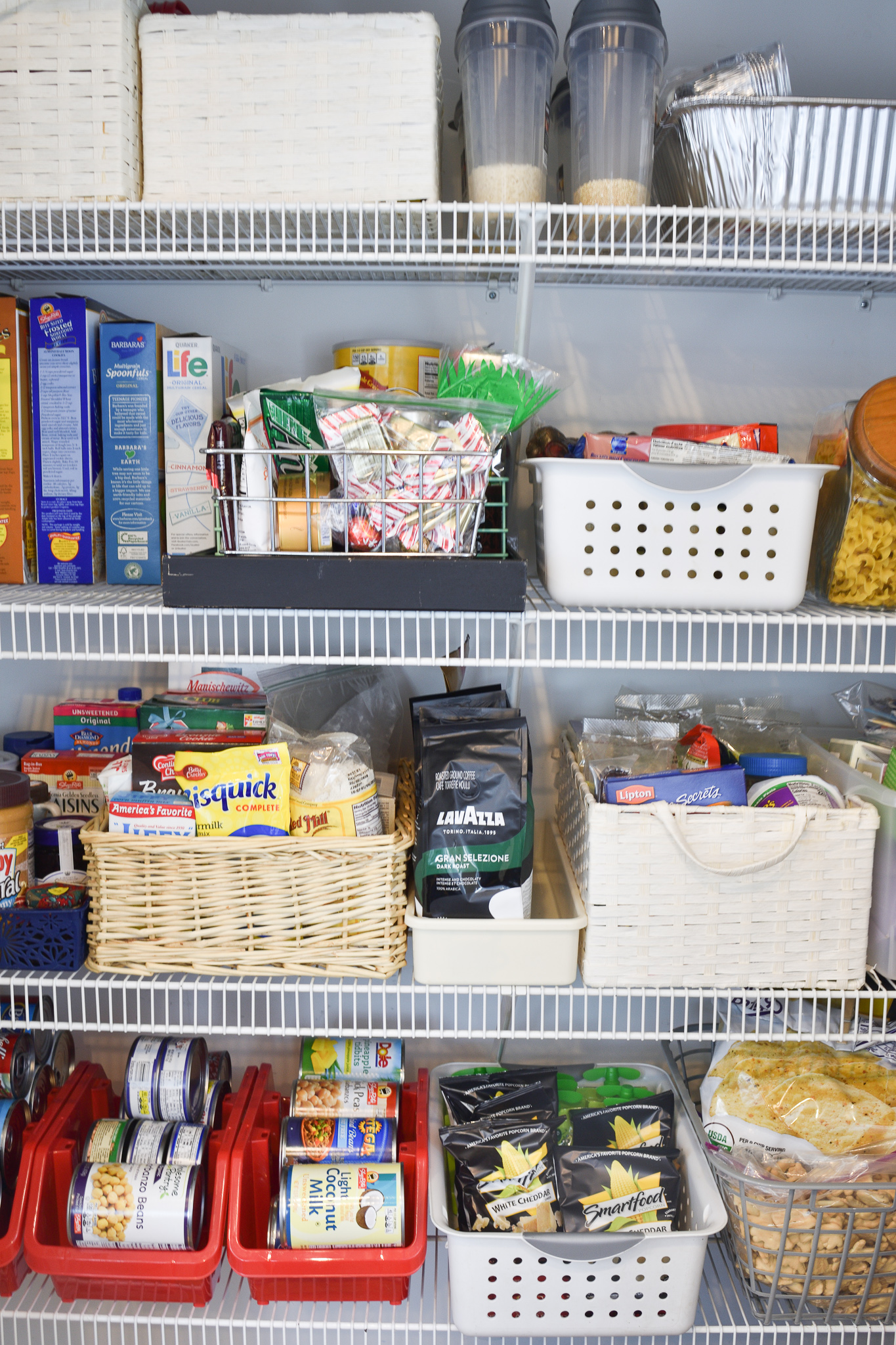 organized pantry shelves with containers - how to organize the pantry