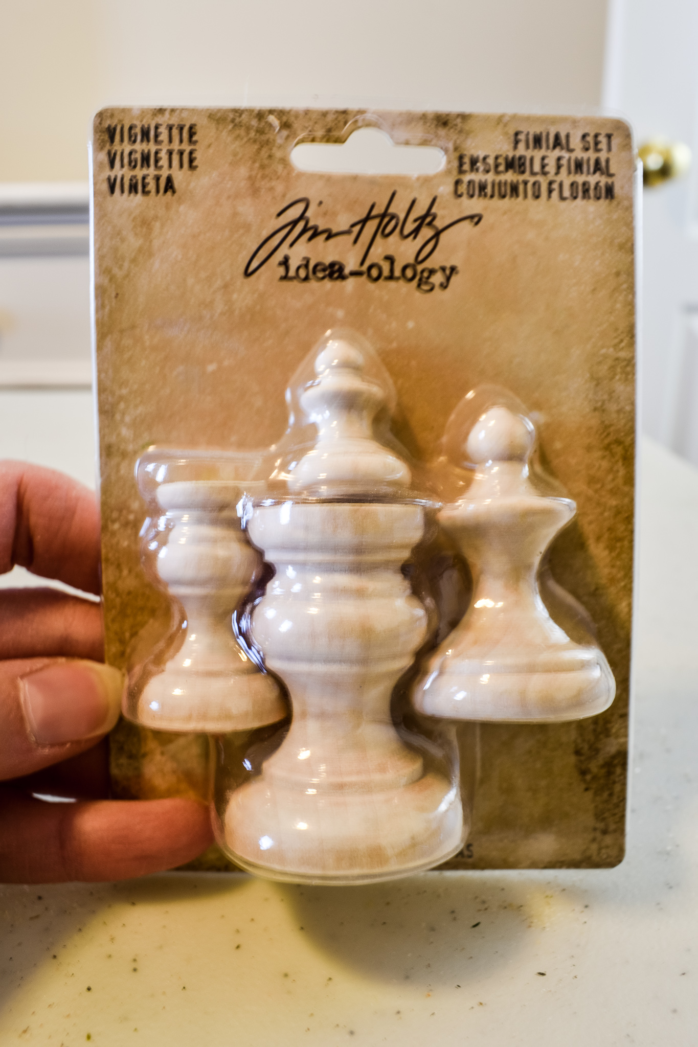package of four unfinished wood finials