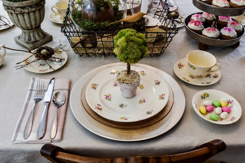 diy moss topiary trees used as favors on a spring tablescape