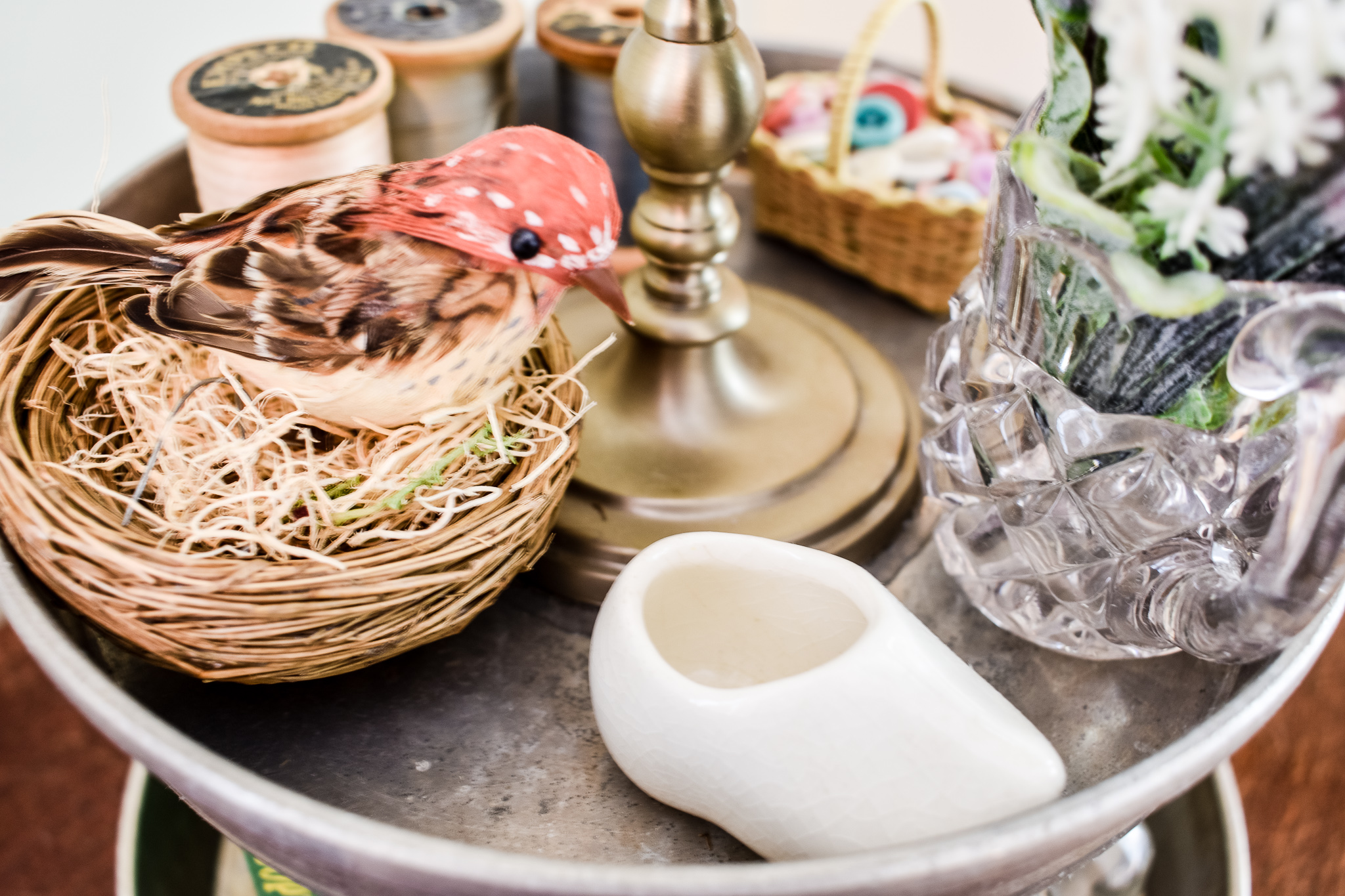 easy diy tiered tray styled with a bird in a nest