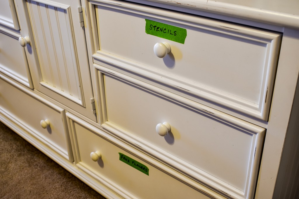 white dresser used to hold craft supplies in a craft room