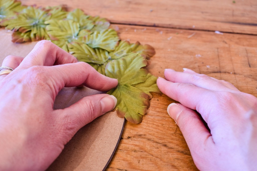 gluing leaves onto a DIY leaf placemat